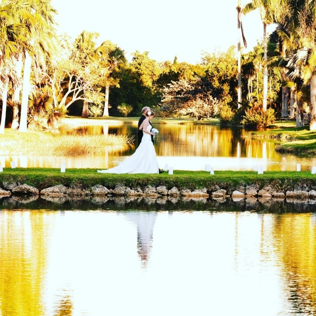 The most important walk of your life starts at sunset as the golden hour light glistens in the air and paradise not only surrounds you, it awaits. . Your dream wedding is a click away ❤️ Link in bio 😊 . 📸: @roy_llera_photographers  #fairchildtropicalbotanicgarden #gardenweddings #outdoorweddings #beautifulplaces